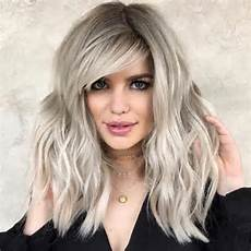 25 latest medium length hairstyles with bangs for 2020