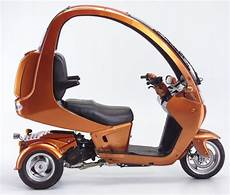 auto moto the auto moto a cool three wheel scooter with a canopy can be driven in the and gets a