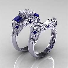 classic 14k white gold three stone princess white and blue sapphire diamond solitaire engagement