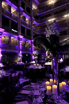 purple and black wedding reception with a bunch of string lights all around andit would be