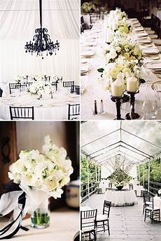 picture of lush white blooms white candles and black vases chairs and chandeliers for chic styling