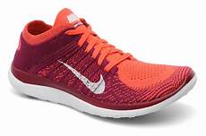 nike wmns nike free 4 0 flyknit sport shoes in orange at
