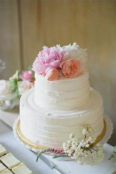top a buttercream covered cake with pretty flowers and voil 224 simple wedding cakes popsugar