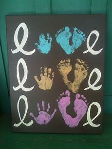 5 hand print activities to do with your 1 year old handprint footprint artwork i so should do this one for