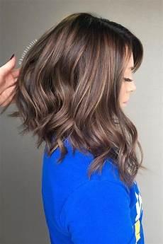 long angled bob haircuts that prove blunt isn t always