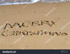 merry christmas written the in the sand 20645386