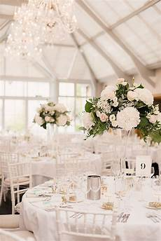 classic wedding at botleys mansion with ellis bridals gown and pastel colour scheme white