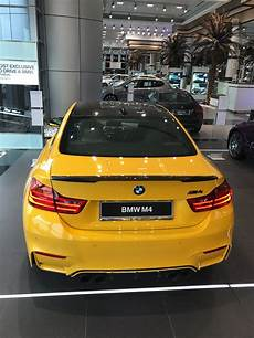 bmw m4 in speed yellow shows up at abu dhabi dealership