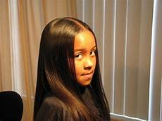 thermal relaxing a child s hair using the best flat iron