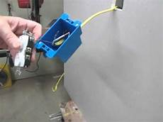 how install an electric outlet in an existing wall youtube