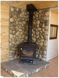 remodeling a stove wall shield with river rock faux rock pinterest stove wall remodeling a stove wall shield with river rock faux rock stove wall brick
