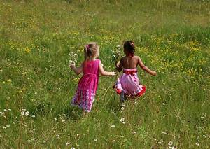 Free Little girls running in field Stock Photo