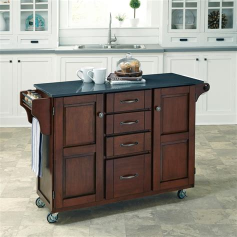 cherry wood kitchen island home styles aspen rustic cherry kitchen island with 5383