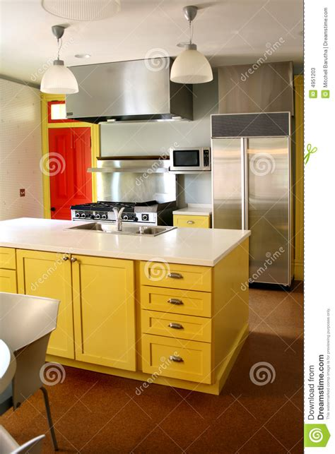 yellow kitchen cabinet kitchen yellow wood cabinets stainless stove stock photos 1213