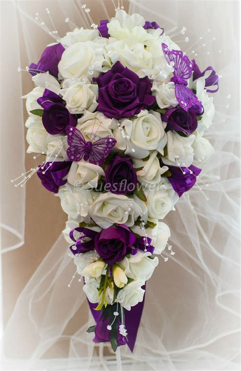 wedding flowers brides teardrop bouquet  cadburys purple