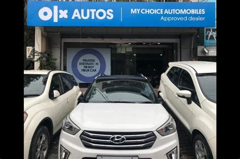 olx autos franchisee model  pre owned car dealerships