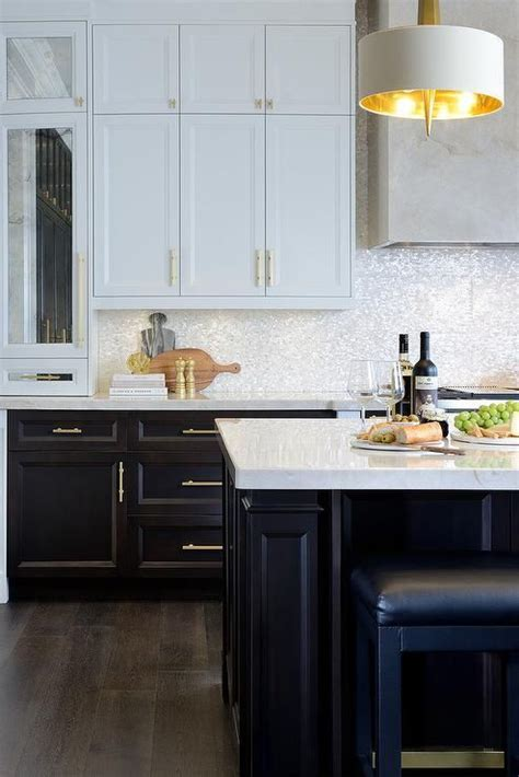 white  brown kitchen features white upper cabinets