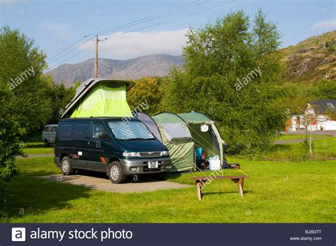 A Small Campervan With Side Awning On A Camp Site At