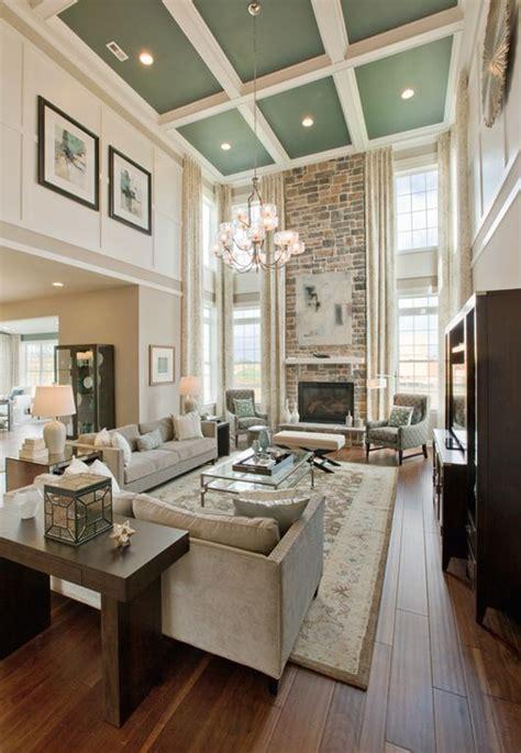living room  high ceilings  fireplace  windows