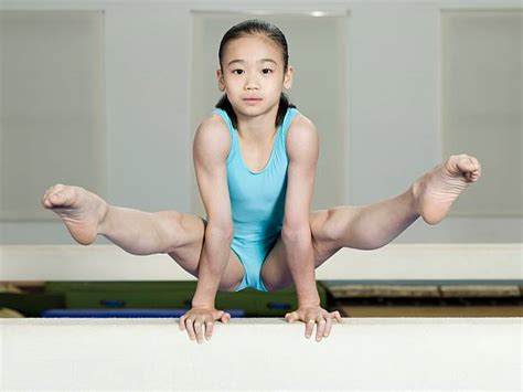 gymnastics leotard  girls balance beam stock