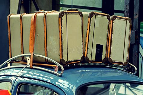 Suitcases On A Luggage Carrier On The Roof Of The Old Car
