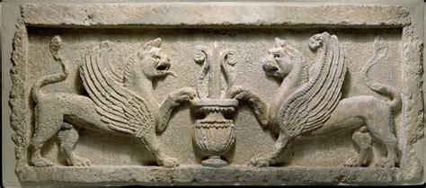 door lintel  lion griffins  vase  lotus leaf