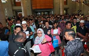 Thousands swarm Immigration Department as E-Card ...