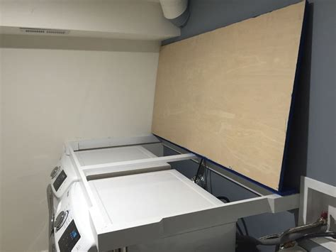 installing countertop   washer dryer carpentry