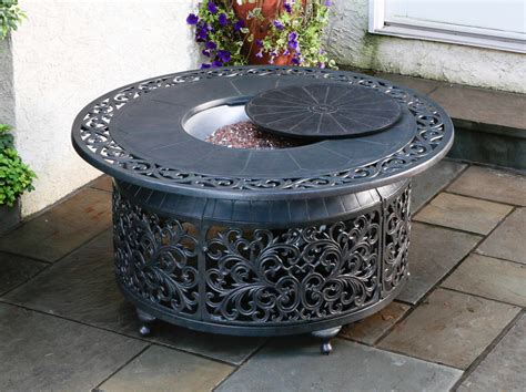 This Fire Pit Is Powered By A Propane Tank That Is