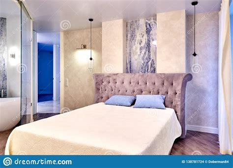 big comfortable bed in luxary bedroom stock