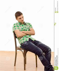 Handsome Young Man Sitting Slumped In A Chair Stock Image ...  Sitting