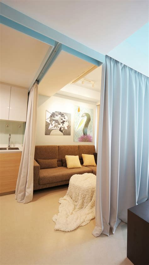 tiny apartment  fabric curtains  divide  spaces
