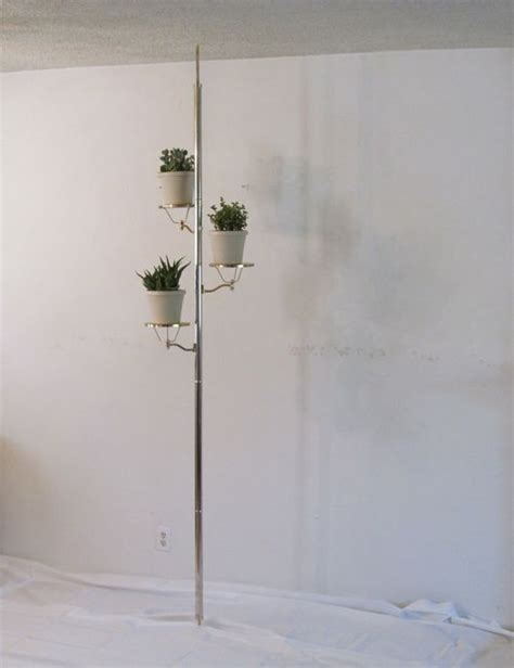 mid century tension pole l plant stands and plants on pinterest