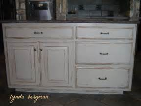 distressed white kitchen island lynda bergman decorative artisan white kitchen cabinets to a painted stained wood look and