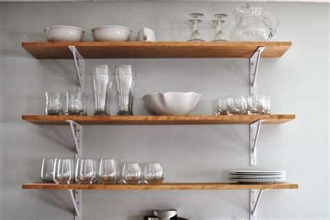 Small Kitchen Makeover Ideas On A Budget - white wall shelves for effective storage in small kitchen midcityeast