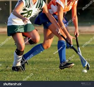 Two Women Battle For Control Of Ball During Field Hockey ...