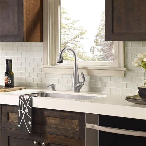 white glass tile backsplash white countertop with wood cabinets home kitchen