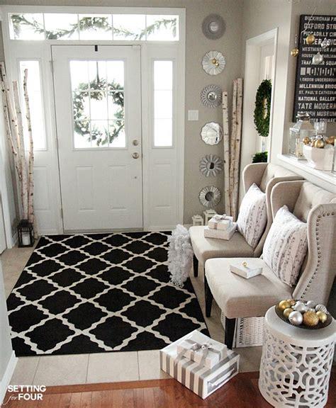 elegant  neutral christmas foyer setting