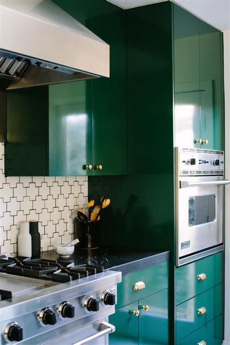 bold kitchen  forest green cabinets  gold metal