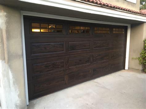 chi walnut color garage door installed  irvine cityscape garage doors