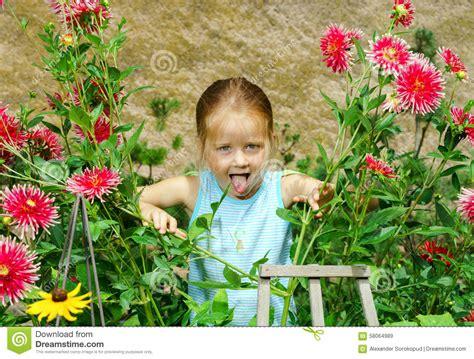 Cute Preschooler Girl Portrait With Natural Flowers Stock