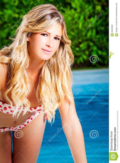 charming blonde girl  swimsuit bikini pool stock photo