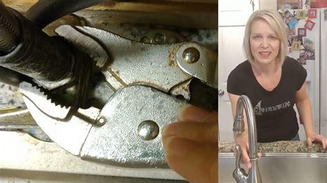 tighten  loose kitchen faucet moen delta