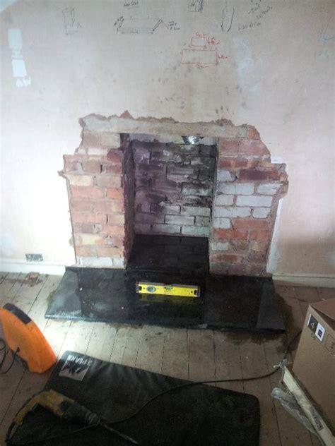 fitting  hearth   wood burning stove log burner