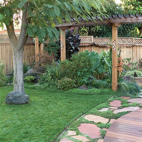 backyard makeover includes path pergola and pond sunset