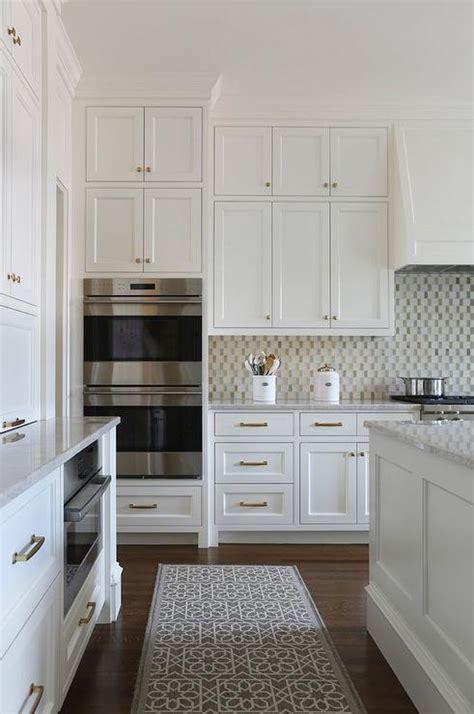 Small KItchen Appliances Garage with Tiled Backsplash