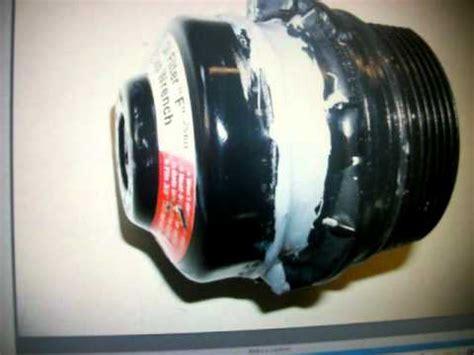 removing  toyota corolla cartridge oil filter housing