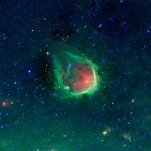 This glowing emerald nebula seen by NASA's Spitzer ...