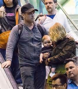 baby crosses lara bingle and sam worthington dote their rocket