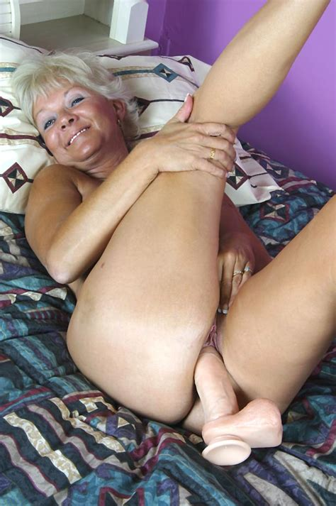 Hot Granny Marcial Takes Out Her Huge Dildo And Traps It Between Her Huge Tits Xxx Milfs